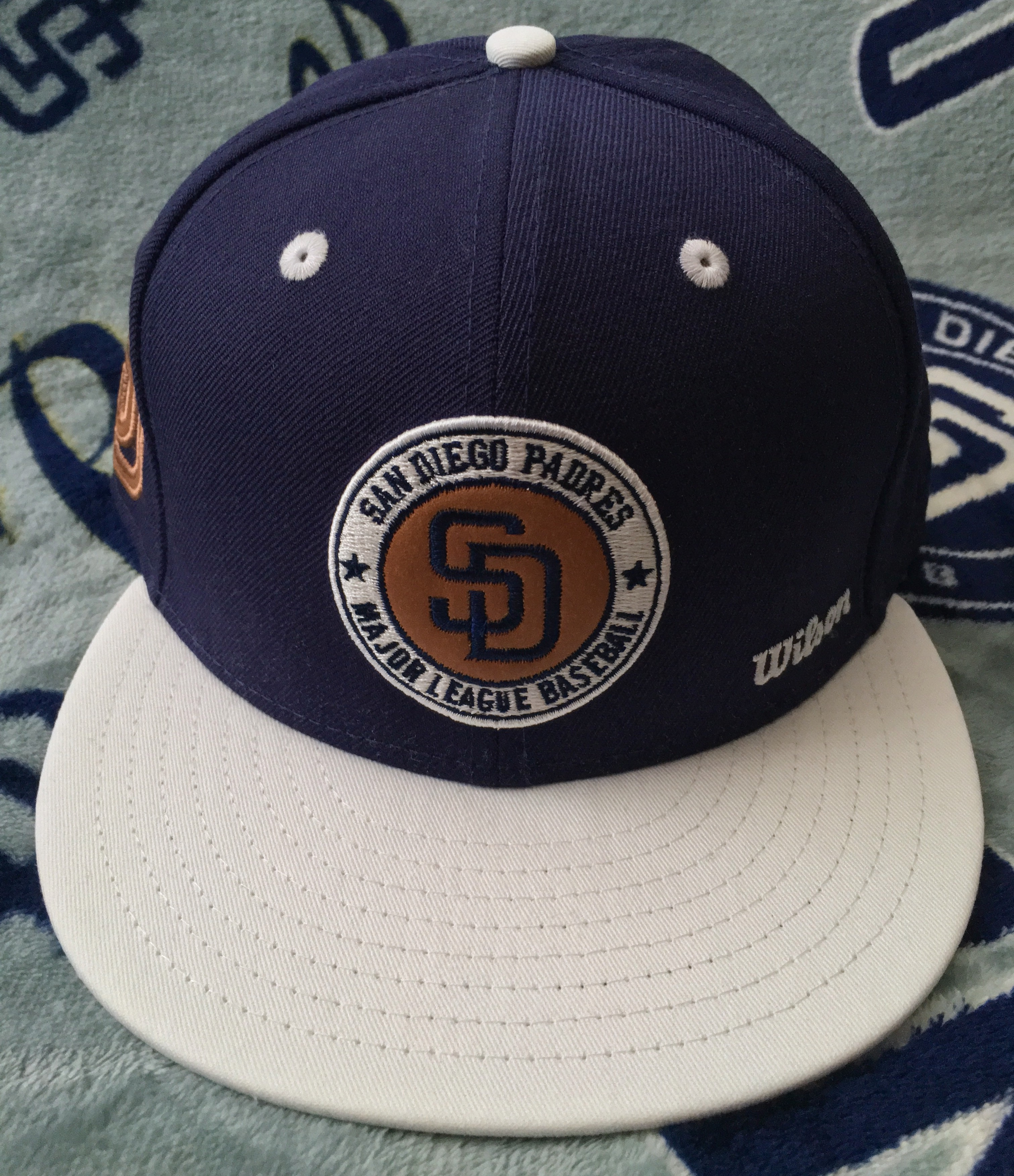 ae51ea8f89a The second of the New Era x Wilson caps is a team colorway-inspired version  with touches of genuine leather throughout. While this cap is a nice  looking ...